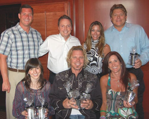 Pictured (L-R): BMI's Mark Mason, Jody Williams, Mary Loving, and David Preston, with (seated) 3 Ring Circus's Casey LeVasseur, Jeffrey Steele, and Stephanie LeVasseur