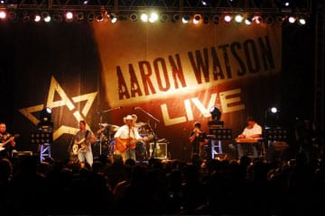 """This past weekend, Texas' own Aaron Watson recorded his next project entitled Deep In The Heart Of Texas:  Aaron Watson LIVE from the Hog Creek Icehouse's backyard amphitheater in Waco, Texas.  This live recording is set to be released as a combo CD/DVD package on September 15.  """"Incredible,"""" was about the only word that Aaron could think of when recapping the electric evening.   With the help of a few thousand fans, Aaron kicked off the exhilarating two-hour show with his first nationwide single """"Love Makin' Song"""" from his most recent album Angels and Outlaws."""