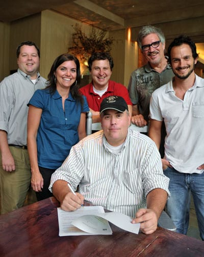 Veteran BMI musician and songwriter Pete Sallis recently inked a deal with premier Christian music publisher Brentwood Benson Publishing Group. Pictured at BMI in Nashville are (back row) BMI's Bradley Collins, Brentwood Benson Publishing Group's Stacey Wilbur, John Andrade, Brentwood Benson's Dale Mathews, and Eric Hurt, with Pete Sallis, seated. (Photo: Drew Maynard)