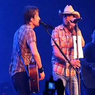 """When country music superstar Keith Urban asked both Dierks Bentley and Jason Aldean to join him on stage for the 1975 Eagles hit """"Take It To The Limit"""" at two separate tour dates in VA and KS, he wasn't prepared for his opening acts to have to think on their feet. Each secretly devised last-minute """"cheat sheets"""" to help them with the song that neither had previously performed live. Bentley scribbled out the lyrics on his forearm with a Sharpie, and Aldean followed by taping the printed lyrics sheet to his mic stand with gaffe tape. Once he realized what both acts were up to, Urban didn't let either get away without a little public humiliation in front of both sold out crowds. Thankfully, the fans were more than happy to come to both Bentley and Aldean's rescue, creating an arena-wide sing-a-long.   For video clips of both, visit http://www.keithurban.net/?em5004=194014_-1__0_~0_-1_7_2009_0_0&content=from_the_road_blog"""