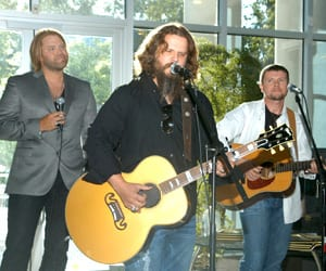 "(L-R): Song of the Year co-writers James Otto, Jamey Johnson and Lee Thomas Miller performed ""In Color."" Photo: Alan Mayor"