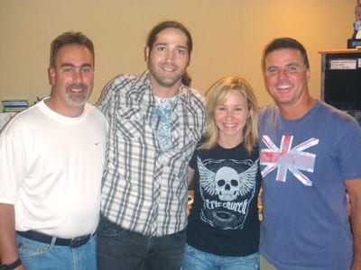 "Columbia Nashville newcomer Josh Thompson hangs out with the KBEQ Morning Drive crew while promoting his debut single, ""Beer On The Table."" Pictured (l-r):  KBEQ's Zeke Montana, Thompson, Natalie Puhr, and PD Mike Kennedy."
