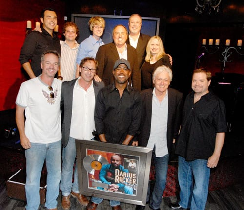 Photo 2: (Top Row L-R) Charles Vegara, (McGhee Entertainment), Jason Hauser (McGhee Entertainment), Melanie Wetherbee (McGhee Entertainment), Doc McGhee (McGhee Entertainment), Mike Dungan (President/CEO Capitol Records Nashville) & Cindy Mabe (SVP Marketing Capitol Records Nashville)  (Bottom Row L-R): Steve Hodges (SVP Promotion Capitol Records Nashville), Scott McGhee (McGhee Entertainment), Rucker, Frank Rand (McGhee Entertainment), & Frank Rogers (Learn to Live Producer).