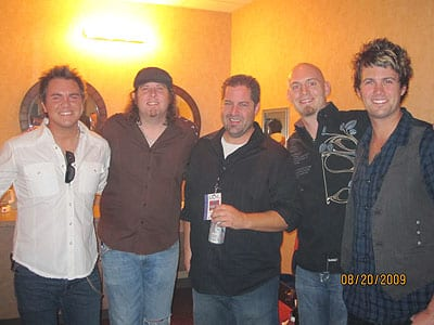 Morning show host Bill Thomas with the Eli Young Band