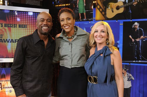 "ABC News anchors Robin Roberts congratulates Darius Rucker and Lee Ann Womack after they announce some of the final nominees for ""The 43rd Annual CMA Awards"" broadcast live on ABC News' ""Good Morning America"" from the their studios in New York City's Times Square on Sept. 9. photo: ABC/ Ida Mae Astute"