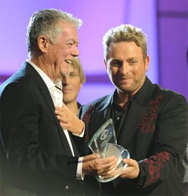 Producer Brent Maher and Johnny Reid accept the CCMA Album of the Year trophy. Photo: Grant W. Martin