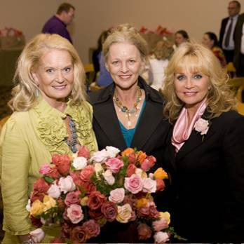 Pictured L to Right: Lynn Anderson, Pat Bullard and Barbara Mandrell stop to smell the roses at a luncheon hosted by Mandrell after Wednesday's dedication of the Nashville Music Garden. (Photo by Katherine Bomboy)