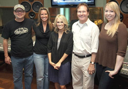 "Superstar Carrie Underwood is red-hot on the airwaves with her smash, ""Cowboy Casanova,"" and she's pictured here in the recording studio recently at work on her third album, Play On, set for release on November 3. Pictured (l-r): Album producer Mark Bright; Sony Music Nashville A&R Exec VP Renee Bell; Underwood; Sony Music Nashville Exec VP Butch Waugh; and 19 Entertainment's Ann Edelblute. Photo Credit: Chris Hollo"