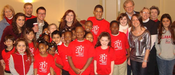 Jo Dee Messina with the Harvest Hands Board of Directors, Concert Organizers and Harvest Hands Kids prior to the Dec. 5th benefit concert