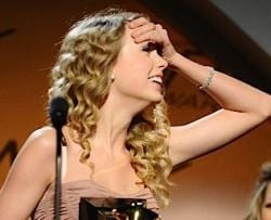Taylor Swift winning Album of the Year.