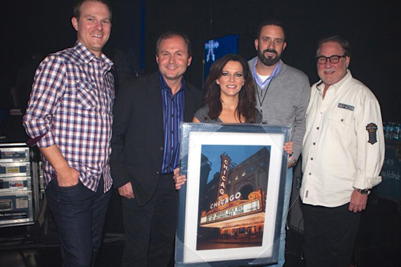 Martina McBride is presented with a plaque depicting a photo of her sold-out concert at the Chicago Theatre. Pictured with McBride (c.) are (l. to r.) Brandon Gill, Morris Artists Management; Don Kronberg, President of NiteLite Promotions; Mike Betterton, Morris Artists Management; Rod Essig, CAA. Photo: RKN Photo