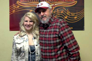 "Josey Milner visited with Renegade Radio Nashville to promote her debut single, ""Not Pretty Enough."" The young singer will be performing at a Renegade Radio showcase concert on February 8 at Nashville's Hard Rock Cafe. Pictured (L-R): Josey and Captain Jack."