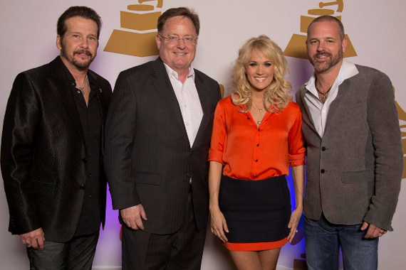Pictured (l to r):  Chair of the Board of Trustees of The Recording Academy, George Flannigen, Sony Nashville chief Gary Overton, Carrie Underwood and Nashville Chapter President Jon Randall Stewart. Photo: The Recording Academy/Ed Rode