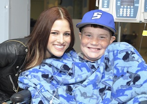 The Voice winner Cassadee Pope visits with a St. Jude patient.