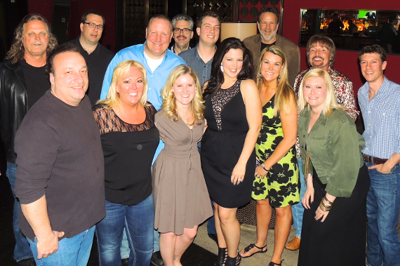 Show Dog Universal Music's Krystal Keith spent some time getting to know radio while in Vegas for the ACM Awards. Pictured (L-R)Front: Marty Mitchell (WKMK/NJ); Robin Rhodes (Premiere Radio); Marci Braun (WUSN/Chicago); Keith; Kim Stewart (KSCS/Dallas); Liz Geerling (WUSN/Chicago). Back: Rick Moxley (SDU); Doug Montgomery (Premium Choice/Clear Channel); Mark Razz (WXTU/Philly); Tom Baldrica (SDU); Mike Sales (WKMK); George Nunes (SDU); Coyote Calhoun (WAMZ/Louisville); Taylor Shults (TKO Artist Management).