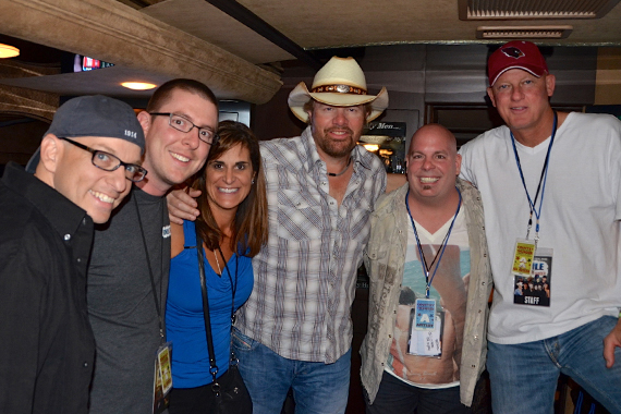 Toby Keith gave Arizona's Country Thunder festival its first-ever complete sell-out in its 25 year history and celebrated KMLE/Phoenix. Pictured (L-R): Tim Richards (PD); Drew Bland (MD); Lisa Owen (Show Dog Universal); Toby Keith; Brad Booker (morning show host); and Tim Pohlman (GM)