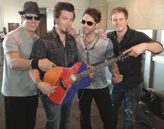Pictured (L to R): Scott Thomas, Josh McSwain, Matt Thomas and Barry Knox post-performance with the official autographed Southwest Airlines Travelin' Taylor Tour custom GS Mini guitar