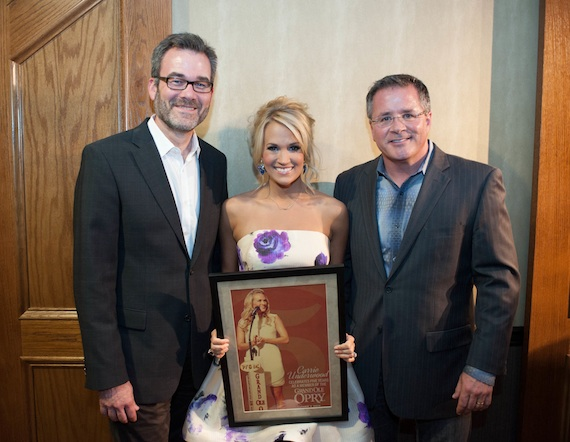 Pictured (L-R): Steve Buchanan/Excecutive Vice President of Opry Entertainment Group, Carrie, Pete Fisher/ Opry President and General Manager with commemorative 5th Opry anniversary printPhoto: Joel Dennis