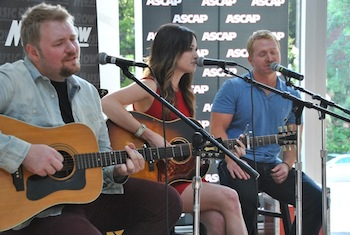 "(L-R): Josh Osborne, Kacey Musgraves and Shane McAnally perform ""Merry Go 'Round."" Photo: Isabel Ross"