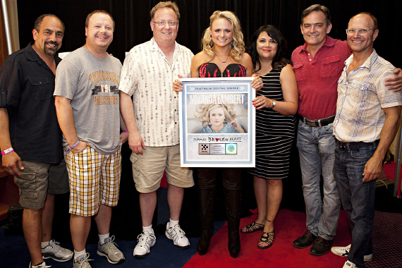 """Miranda Lambert and Sony Music Nashville staffers were all smiles Thursday for the opening night of the four day CMA Music Festival. Backstage at LP Field before her show, SMN CEO/Chairman Gary Overton & staff surprised Lambert with a platinum plaque for """"Mama's Broken Heart."""" Pictured (L-R): Paul Barnabee; Josh Easler; Gary Overton; Lambert; Caryl Healey; Wes Vause. Photo: Brian Kaplan"""