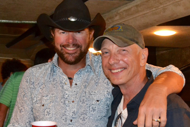"""Toby Keith took his Hammer Down tour to Pittsburgh promoting his latest single """"Drinks After Work"""" which takes home the greatest spin increase this week. Pictured with WDSY APD/MD Stoney Richards."""