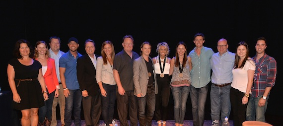 Pictured (L-R): Big Yellow Dog's Carla Wallace, Bug Music's Sara Johnson, BMI's Bradley Collins, host Cody Alan, BMI's Jody Williams, Sony Music Nashville's Lesly Tyson and Gary Overton, co-writer Josh Kear, Carrie Underwood, co-writer Hillary Lindsey, ASCAP's Ryan Beuschel, producer Mark Bright, and BMG Chrysalis' Taylor Lindsey and Kevin Lane.
