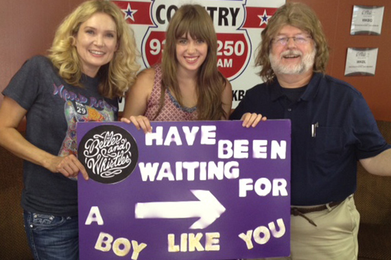 "Mother-daughter duo Belles And Whistles have been touring Country radio in promotion of ""Boy Like You."" Pictured here with U.S. 51's Rob Grayson."