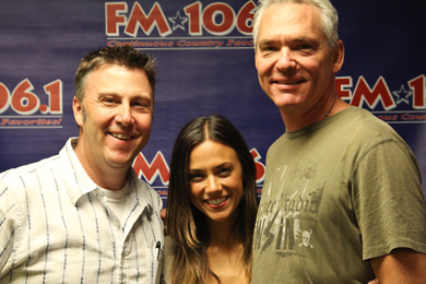 "Jana Kramer recently visited WMIL in promotion of her No. 55 single, ""I Hope It Rains."" Pictured (L-R): Tom Martens (W.A.R.), Jana Kramer and Kerry Wolfe (PD-WMIL)"