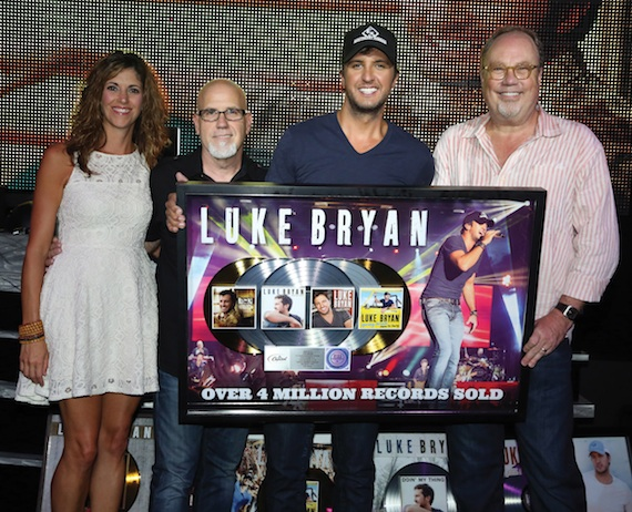 Pictured (L-R): Kerri Edwards, Red Light Management; Jeff Stevens, Producer; Luke Bryan and UMG Nashville Chairman & CEO, Mike Dungan.