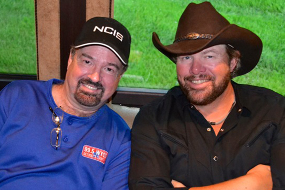 "Toby Keith (R) brought his ""Hammer Down"" Tour to Detroit and before the show, had some couch time with WYCD Morning show host Dr. Don Carpenter (L)"