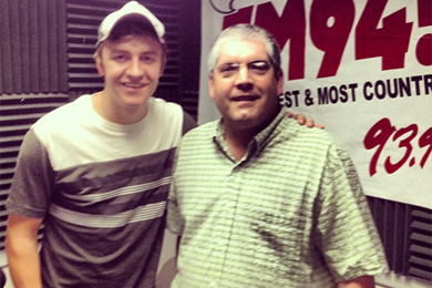 """YN Records' Tyler Barham (L)recently visited WMEV's Lynn Rutledge (R) in promotion of his No. 67 single, """"17 & Young."""""""