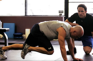 Daniel Meng (right) coaches Kenny Chesney through a workout.