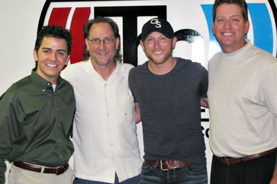 "Cole Swindell continued his radio tour with a stop in Oklahoma City, OK to meet with KJKE in support of his debut No. 49 Warner Bros. single ""Chillin' It."" Pictured (L-R): Owen Pickard (KJKE MD), Mark Niederhauser (WMN), Cole Swindell and Kevin Christopher (KJKE PD)."