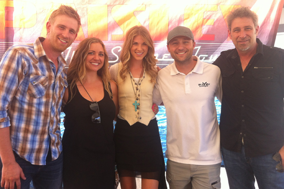 "Arista Nashville's The Henningsens visited with KEGA in promotion of their No 35 single ""I Miss You"" before playing Salt Lake City last Friday on Brad Paisley's Beat This Summer Tour. Pictured (L-R): Aaron Henningsen, Amanda (KEGA's AM Show), Clara Henningsen, Jon Watkins (KEGA PD), Brian Henningsen"