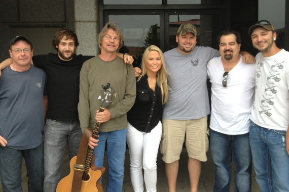 Rachel Holder recently visited with MusicRow Chart Reporter Toby Tucker at WDZQ in Decatur, IL on the way to her show at Fuddfest in Deerbrook, WI. Pictured (L-R) Greg Rudder, Chris Potocik, Stuart Weed, Rachel Holder, Toby Tucker, Kevin Moore and Mike Barnes.
