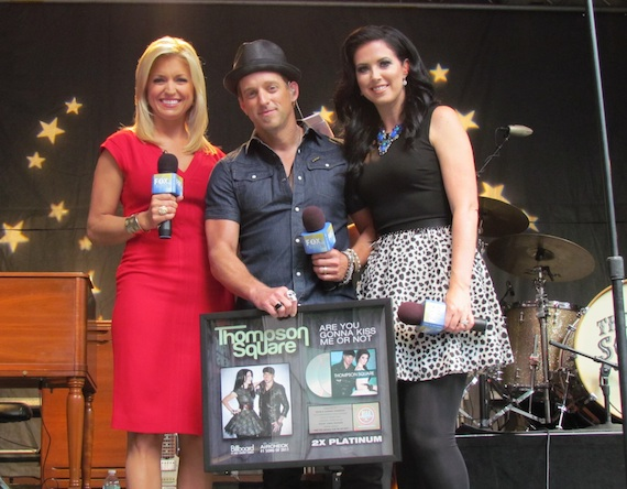 "Pictured (L-R): FOX & Friends' Ainsley Earhardt and Keifer and Shawna Thompson of Thompson Square celebrate over two million in sales forThompson Square's hit, ""Are You Gonna Kiss Me Or Not."""