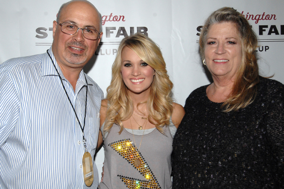 Carrie Underwood recently played Puyallup's Washington State Fair where she visited with KKWF Seattle PD Mike Preston and his wife Terri. Pictured (L-R): Preston, Underwood, Yankovich