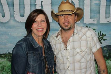 WFMS' Tammy Lively (L) recently welcomed Jason Aldean to Indianapolis where he wrapped a concert season at Klipsch