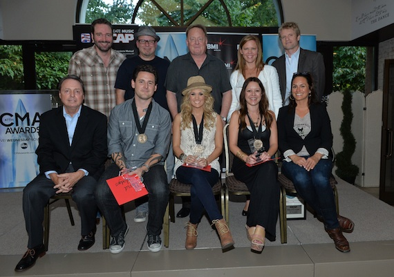 Pictured (back row L-R): EMI's Josh Van Valkenburg, producer Mark Bright, Sony Music Nashville's Gary Overton and Lesly Tyson and BMG Chrysalis' Kos Weaver. (front row L-R): BMI's Jody Williams, David Hodges, Underwood, Hillary Lindsey and ASCAP's LeAnn Phelan. Photo: Rick Diamond