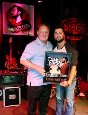 "Pictured (L-R): Sony Music Nashville Chairman and CEO Gary Overton and Columbia Nashville artist Tyler Farr celebrate 5 million views on VEVO for ""Redneck Crazy."" Photo credit: Alan Poizner"
