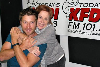 "Atlantic/Warner Bros. artist Brett Eldredge (L) recently spent some time on air with KFDI MD Carol Hughes (R) promoting his latest single ""Beat Of The Music,"" which lands On Deck this week."