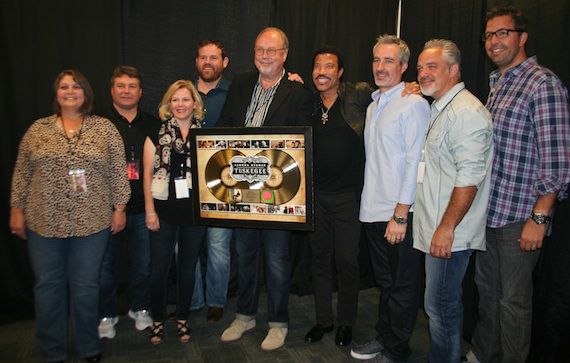 Pictured (L-R):  Ellen Powers, Tom Becci, Katie Dean, Royce Risser, Mike Dungan (UMGN Chairman & CEO), Lionel Richie, Brian Wright, Damon Moberly and Tom Lord.