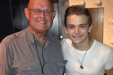 """Atlantic/WMN star Hunter Hayes (R) recently visited with WCYQ's Mike Hammond (L) in Knoxville for his Let's Be Crazy Tour kickoff. Hayes' latest single """"Everybody's Got Somebody But Me,"""" featuring Jason Mraz, lands at our No. 27 spot this week."""