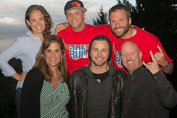 One lucky KUPL winner and 50 of their friends were treated to a Joel Crouse acoustic backyard show. Pictured (back row):  KUPL Morning show DJs Monica, Howie and Jake.(front row): SDU's Lisa Owen, Crouse and KUPL Promotion Director
