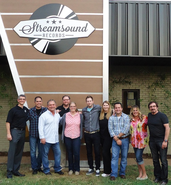 Streamsound Records executives and staff gather in front of their new offices. Pictured below L to R are: Steve Richardson (COO), Steve Pleshe (Regional), Mike Culotta (President), Eric Beggs (Regional), Mary McAllister (Office Coordinator), Tyler Waugh (Regional), Theresa Ford (Regional), Stan Marczewski (Regional), Cheri Cranford (Office Manager) and Byron Gallimore (CEO)