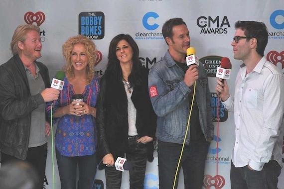 """CMA Vocal Group of the Year Little Big Town recently visited with Premiere Networks personality Bobby Bones prior to the annual awards show in promotion of this week's No. 26 Capitol Nashville single, """"Sober."""" Pictured (L-R): LBT's Phillip, Kimberly, Karen, Jimmy, and Bobby Bones."""