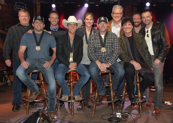 ( l-r): ASCAP's Mike Sistad, This Music's Rusty Gaston, co-writer Ross Copperman, BMI's Perry Howard, Sony ATV Music Publishing Josh Van Valkenburg, and producer Jeremy Stover; (front row, l-r): co-writer Rhett Akins, Justin Moore, co-writer Ben Hayslip, and Big Machine Label Group's Scott Borchetta
