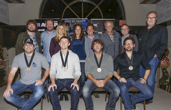 Pictured (L-R, Back row): Combustion's Chris Van Belkom, Sony/ATV's Josh Van Valkenburg, BMI's Leslie Roberts, ASCAP's LeAnn Phelan, producer Dann Huff, Combustion's Chris Farren, Warner/Chappell's Steve Markland and UMG's Mike Dungan. Pictured (L-R, Front row): Songwriters Rhett Akins and Ashley Gorley, Billy Currington and songwriter Chris DeStefano. Photo by Ed Rode.