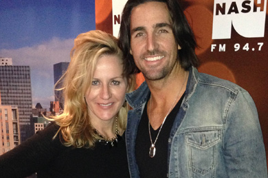 Jake Owen (R) recently celebrated the release of his new album, Days Of Gold, in New York with WNSH's Kelly Ford (L).