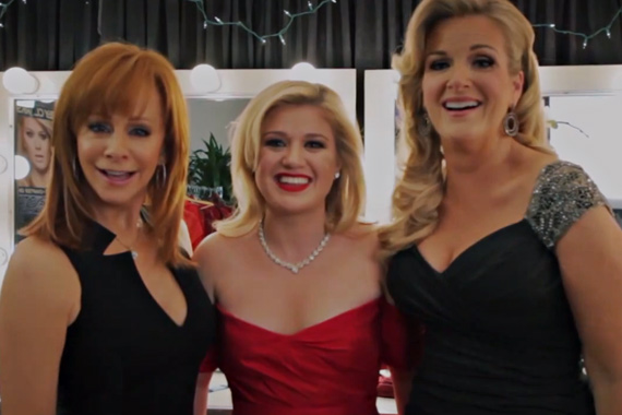 Kelly Clarkson visited with Reba McEntire and Trisha Yearwood prior to filming her NBC Christmas special: Kelly Clarkson's Cautionary Christmas Music Tale. Pictured (L-R): Kelly Clarkson, Trisha Yearwood, Reba McEntire. Photo: Justin Lubin/NBC